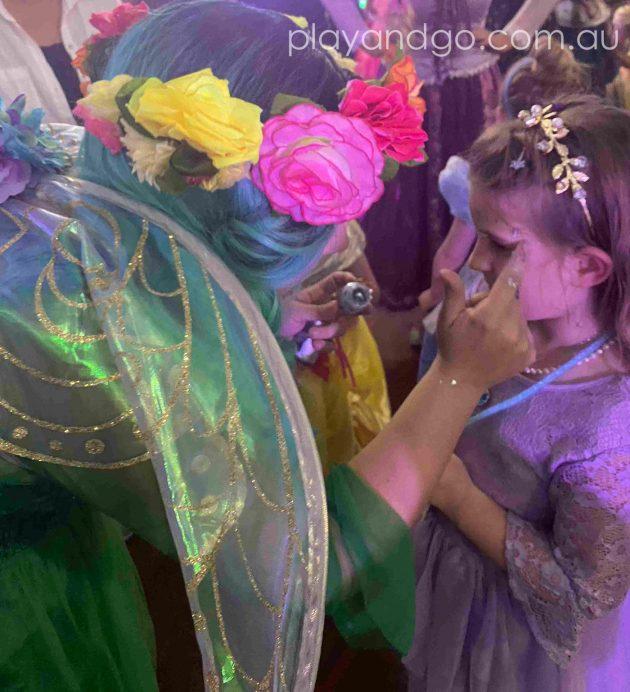 Getting glitter make up at The Royal Princess Ball Image Credit Susannah Marks
